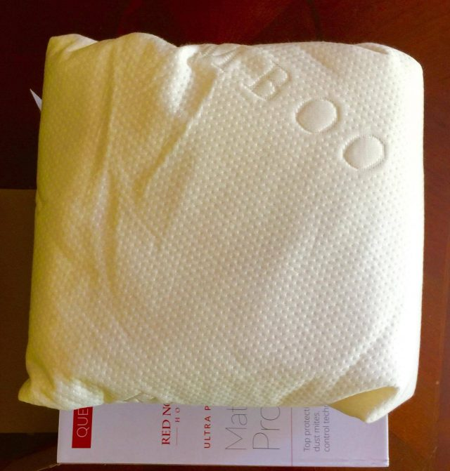 Red Nomad Mattress Protector on Box